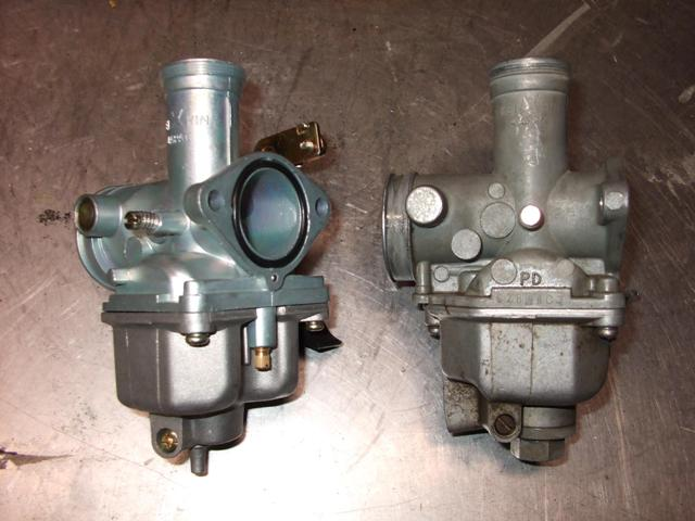 comparison of ebay carb on left and oem carb on right